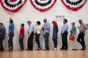 Voters waiting to vote in polling place. Civic engagement
