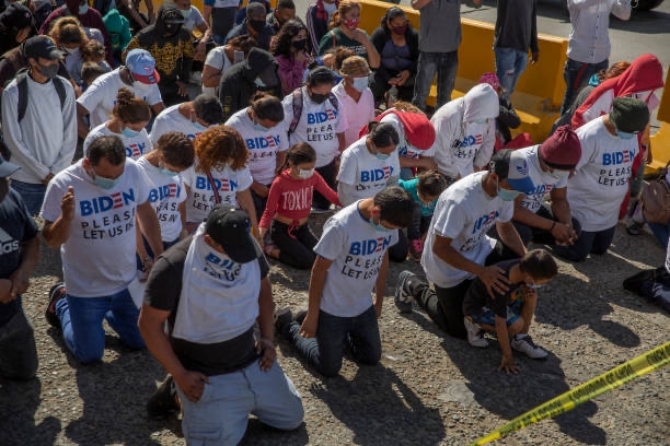 Migrants at the border between Mexico and the USA