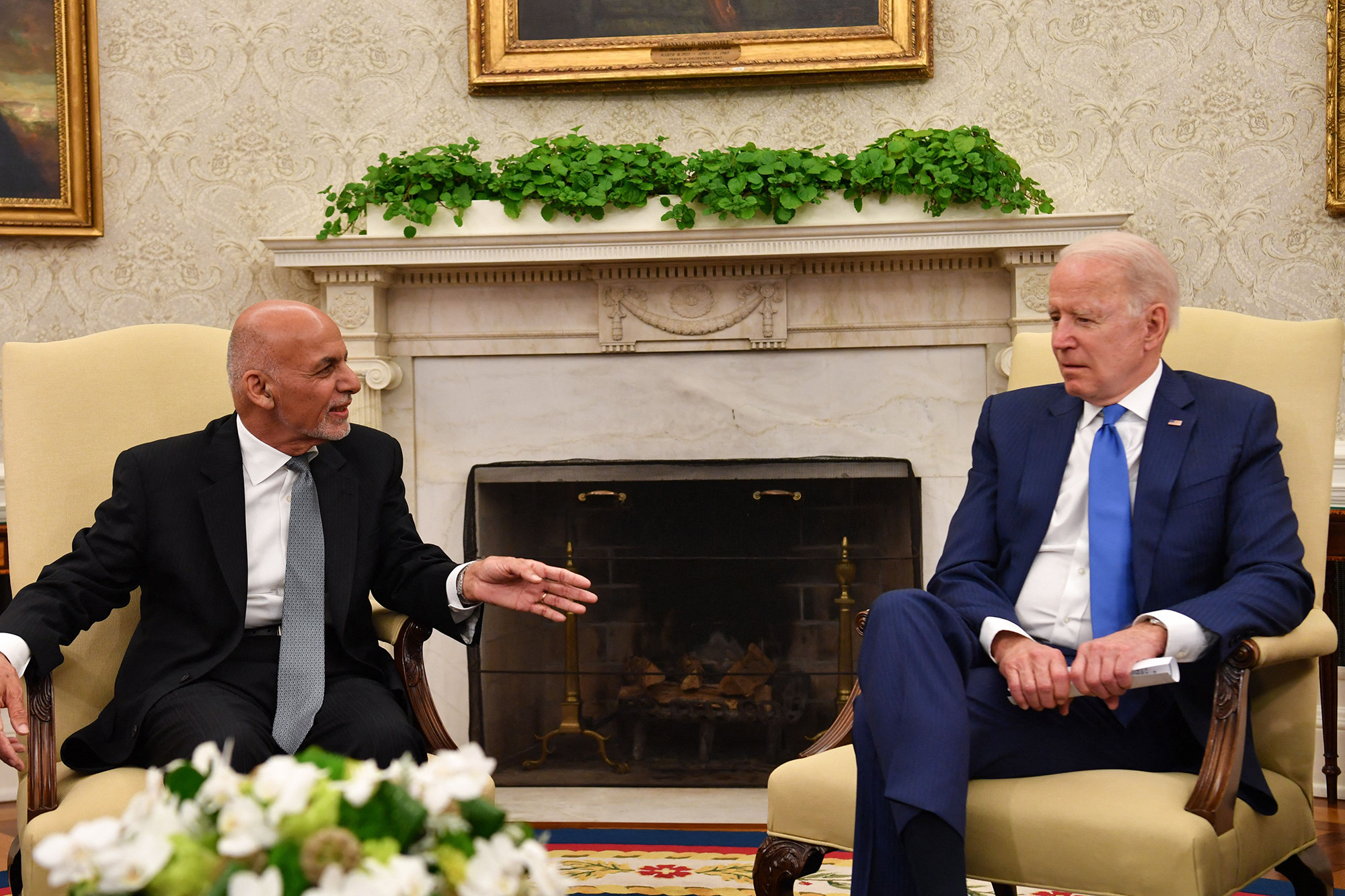 Then-Afghanistan president Ashraf Ghani (left) and President Joe Biden