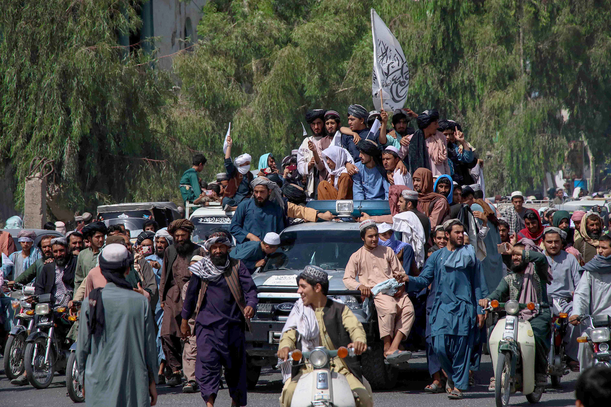 Taliban fighters rally to celebrate the withdrawal of US forces in Kandahar.